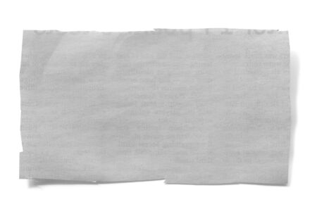 Piece of cut newspaper, isolated on white with soft shadow. Lots of copy-space.