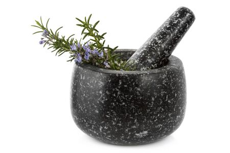 Granite mortar and pestle with sprigs of fresh rosemary, isolated on white. photo
