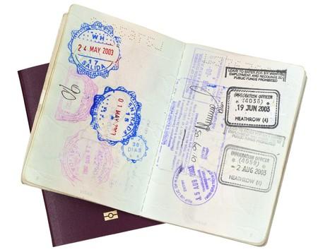 Visa stamps in open passport, over closed EU passport.   photo