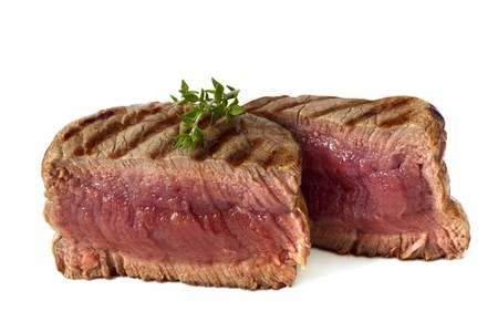 beef tenderloin: Filet mignon, char-grilled to medium rare.  Isolated on white. Stock Photo