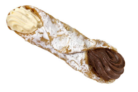 Single cannoli, isolated on white background.  Delicious Sicilian pastry filled with vanilla and chocolate cream. photo