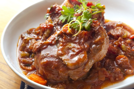 veal: Classic osso buco.  Veal shanks slow cooked with tomatoes, carrots and onion.  Hearty, warming food.
