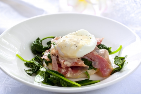 poached: Eggs Benedict.  Toasted muffin topped with wilted spinach, ham, poached egg, and rich hollandaise sauce.  Delicious!