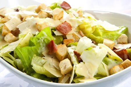 caesar salad: Caesar salad, with kos lettuce, bacon, croutons, parmesan, and creamy dressing. Stock Photo