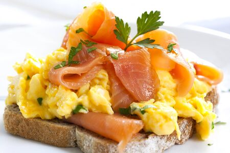 scrambled: Scrambled eggs with smoked salmon, on sourdough toast.