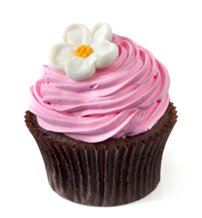 muffins: Chocolate cupcake with pink frosting and a white flower, isolated on white.