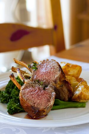 Rack of lamb with broccolini and roasted potatoes. photo