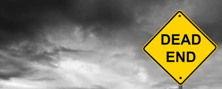 Dead end sign with dark storm clouds behind. Stock Photo - 8934966