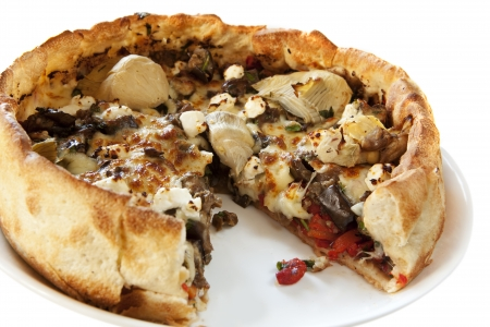 Chicago style deep dish pizza.  Topped with artichokes, olives, peppers, feta and mozzarella cheeses. photo