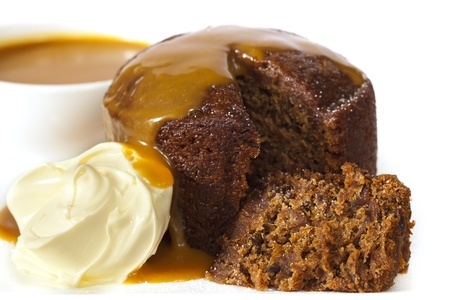 Sticky date pudding topped with caramel sauce and fresh cream.  Delicious! photo