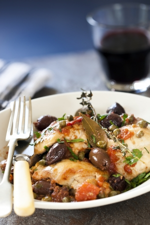 capers: Chicken cacciatore, with olives, capers, tomatoes, garlic and herbs.  Delicious! Stock Photo