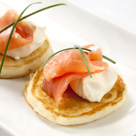 blini: Blini topped with smoked salmon and sour cream.