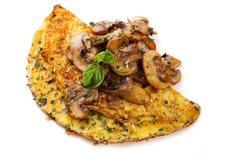 Omelet with grilled mushrooms and herbs, isolated on white background.