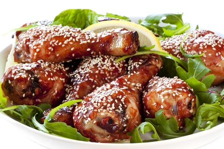 Chicken drumsticks with a sticky hoisin sauce and sesame seeds.