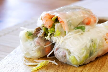 appetiser: Vietnamese rice paper rolls with prawns, pork and bean sprouts. Stock Photo