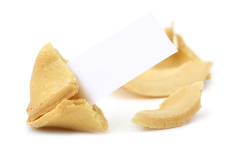 Fortune cookie, broken open with blank tag ready for your message.  Isolated on white. photo
