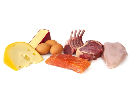 Foods rich in protein, including cheese, eggs, fish, lamb, beef and chicken.  Nutritious eating. Stock Photo