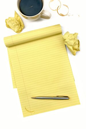 Blank lined notepad with pen, cup of coffee, and crumpled balls of paper. Stock Photo - 9501945