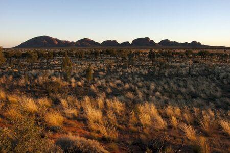 previously: Kata Tjuta, Australia - May 11, 2008:  Sunrise over Kata Tjuta (previously known as the Olgas), Central Australia.  This Australian icon is sacred to its Aboriginal owners. Editorial