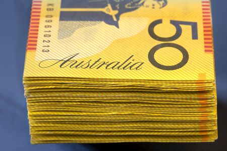 fifty dollar bill: Stack of Australian fifty dollar bills.  Shallow focus.