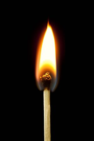 Closeup of burning match, isolated on white background.  Great detail. photo