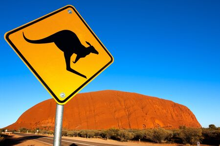 territory: Uluru, Northern Territory, Australia - May 12, 2008:  Kangaroo warning sign at Uluru (Ayers Rock), Northern Territory.  This World Heritage listed site is Australias most iconic image, the largest monolith in the world.