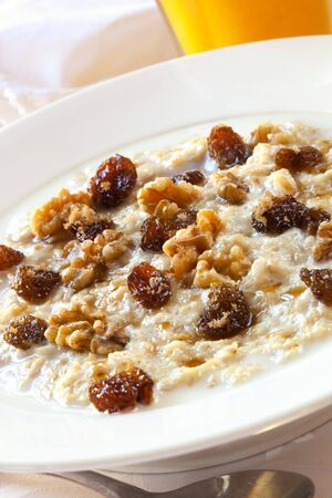 Oatmeal topped with raisins, walnuts and brown sugar.  Delicious healthy porridge. Stock Photo - 9674005