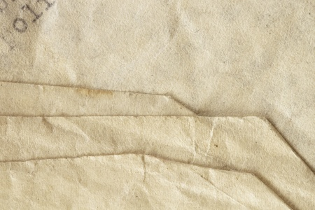 Grungy paper background.  Macro of folds in old typed letter. Stock Photo - 9887857