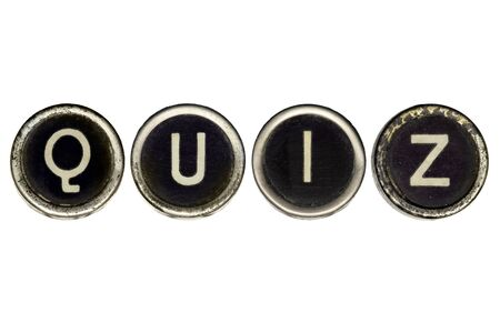 Quiz spelled in vintage typewriter keys.  Isolated on white.  Lots of dust and scratches on the keys. photo