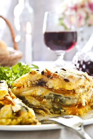Vegetarian lasagne with a glass of red wine. photo