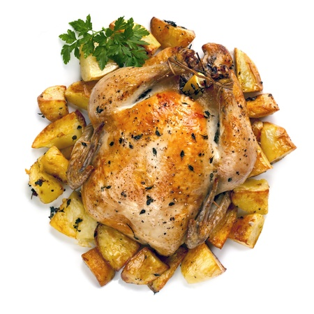 Roasted organic chicken with potatoes.  Hot, succulent and delicious. photo