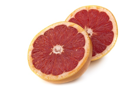 ruby red: Cut grapefruit, isolated on white background.