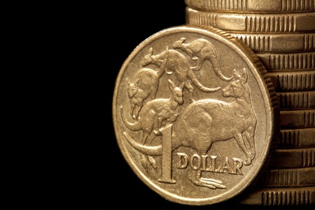 Australian dollar coins, over black background. photo