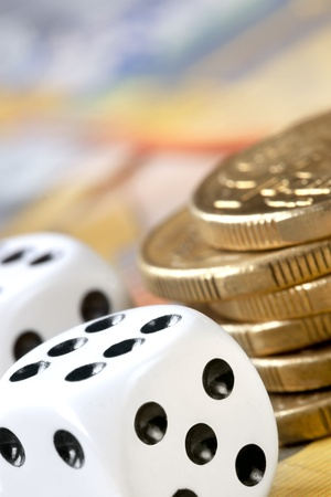 australian dollars: Dice with stack of gold coins.  These are Australian dollars. Stock Photo