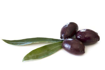 kalamata: Black kalamata olives with olive leaves, isolated on white.