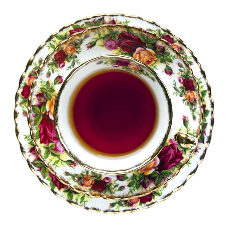 china rose: Tea in English fine bone china teacup.  Overhead view, isolated on white.