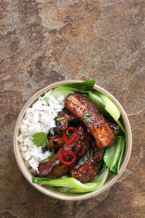 chinese meal: Barbecued pork spareribs with rice and Asian greens. Stock Photo