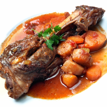 lamb shank: Lamb shank, slow-cooked with root vegetables.  Delicious, hearty eating.