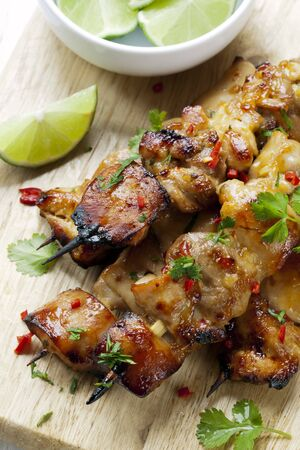 chicken kebab: Thai chicken skewers marinated with chili, coriander or cilanto, and lime.
