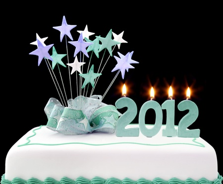 written date: Fancy cake with 2012 candles.  Perfect to celebrate the new year.   Stock Photo