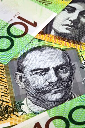 Australian one hundred dollar bills, in close-up.