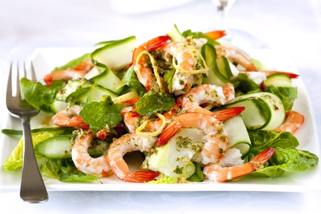 seafood salad: Shrimp or prawn salad, with baby cos lettuce, cucumber, and a healthy lemon, mint and parsley dressing. Stock Photo