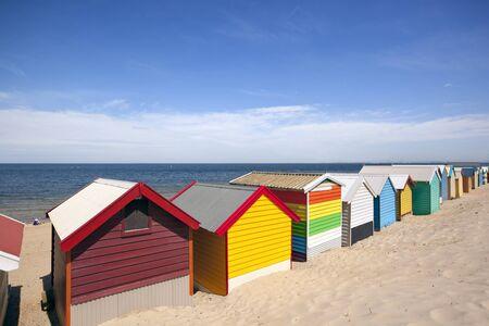 Beach boxes at Brighton Beach, Melbourne, Australia.  Overlooking Port Philip Bay. photo