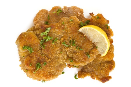 schnitzel: Schnitzel, garnished with lemon and parsley, isolated on white.