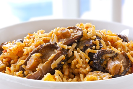 shitake: Rice with shitake mushrooms.  This is West African jollof rice.  Delicious, healthy eating.