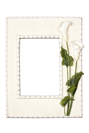 Old picture frame adorned with white lilies.  Isolated on white. photo