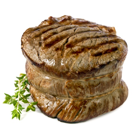 Filet mignon, chargrilled to perfection.  Isolated on white. photo