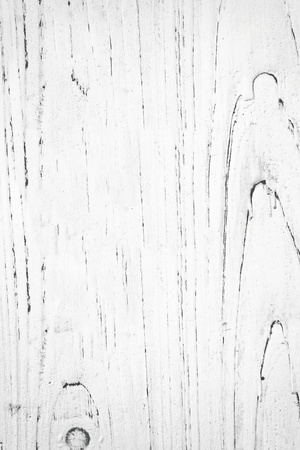 painted wood: White painted grunge timber, showing the grain.