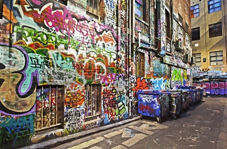 city alley: Grunge alley covered in graffiti.  Hosier Lane, Melbourne, Australia.  HDR effects.
