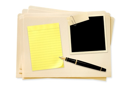 paperclip: Stack of manila file folders, with blank vintage photo paperclipped, with yellow notepaper and fountain pen.